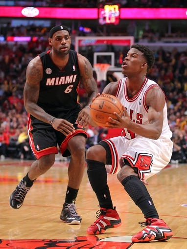 May 10, 2013; Chicago, IL, USA; Chicago Bulls small forward Jimmy Butler (21) is defended by Miami Heat small forward LeBron James (6)during the second half in game three of the second round of the 2013 NBA Playoffs at the United Center. Miami won 104-94. Mandatory Credit: Dennis Wierzbicki-USA TODAY Sports