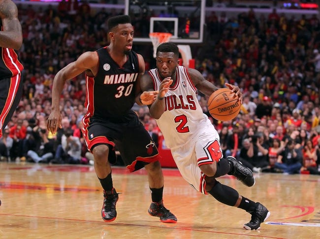 May 10, 2013; Chicago, IL, USA; Chicago Bulls point guard Nate Robinson (2) drives around Miami Heat point guard Norris Cole (30) during the second half in game three of the second round of the 2013 NBA Playoffs at the United Center. Miami won 104-94. Mandatory Credit: Dennis Wierzbicki-USA TODAY Sports