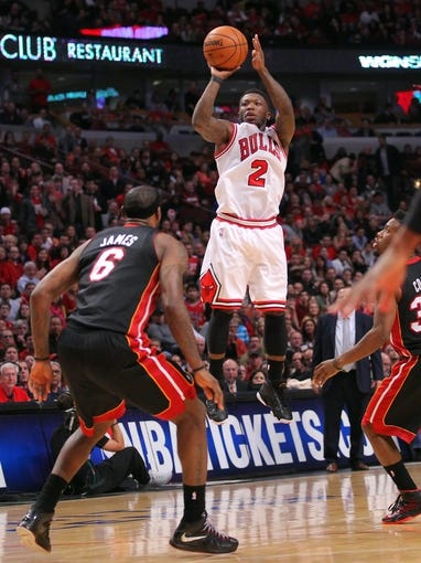 May 10, 2013; Chicago, IL, USA; Chicago Bulls point guard Nate Robinson (2) shoots over Miami Heat small forward LeBron James (6) during the second half in game three of the second round of the 2013 NBA Playoffs at the United Center. Miami won 104-94. Mandatory Credit: Dennis Wierzbicki-USA TODAY Sports