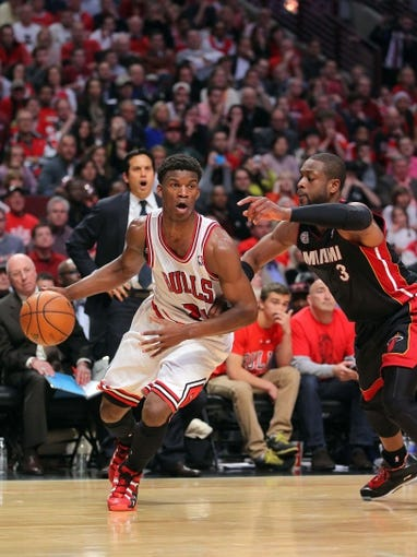 May 10, 2013; Chicago, IL, USA; Chicago Bulls small forward Jimmy Butler (21) drives past Miami Heat shooting guard Dwyane Wade (3) during the second half in game three of the second round of the 2013 NBA Playoffs at the United Center. Miami won 104-94. Mandatory Credit: Dennis Wierzbicki-USA TODAY Sports