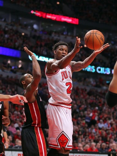 May 10, 2013; Chicago, IL, USA; Chicago Bulls small forward Jimmy Butler (21) makes a pass during the second half in game three of the second round of the 2013 NBA Playoffs against the Miami Heat at the United Center. Miami won 104-94. Mandatory Credit: Dennis Wierzbicki-USA TODAY Sports