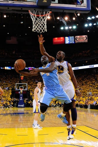May 2, 2013; Oakland, CA, USA; Denver Nuggets point guard Ty Lawson (3) shoots against Golden State Warriors power forward Carl Landry (7) during the third quarter of game six of the first round of the 2013 NBA Playoffs at Oracle Arena. The Warriors defeated the Nuggets 92-88. Mandatory Credit: Kyle Terada-USA TODAY Sports