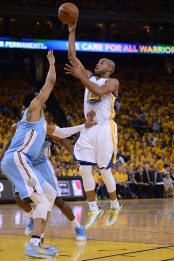 May 2, 2013; Oakland, CA, USA; Golden State Warriors point guard Jarrett Jack (2, right) shoots against the Denver Nuggets during the first quarter of game six of the first round of the 2013 NBA Playoffs at Oracle Arena. Mandatory Credit: Kyle Terada-USA TODAY Sports