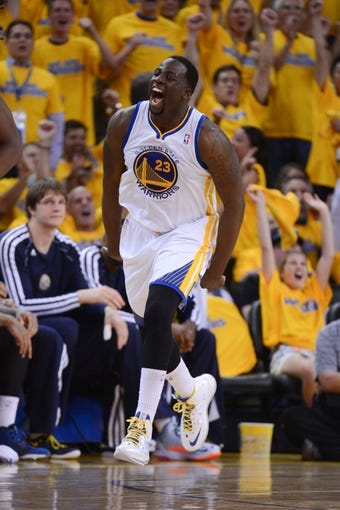 May 2, 2013; Oakland, CA, USA; Golden State Warriors small forward Draymond Green (23) celebrates after making a basket against the Denver Nuggets during the fourth quarter of game six of the first round of the 2013 NBA Playoffs at Oracle Arena. The Warriors defeated the Nuggets 92-88. Mandatory Credit: Kyle Terada-USA TODAY Sports