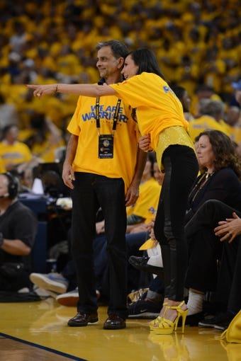 May 2, 2013; Oakland, CA, USA; Golden State Warriors vice chairman Vivek Ranadive (left) and Nicole Curran (right) talk during the fourth quarter of game six of the first round of the 2013 NBA Playoffs against the Denver Nuggets at Oracle Arena. The Warriors defeated the Nuggets 92-88. Mandatory Credit: Kyle Terada-USA TODAY Sports