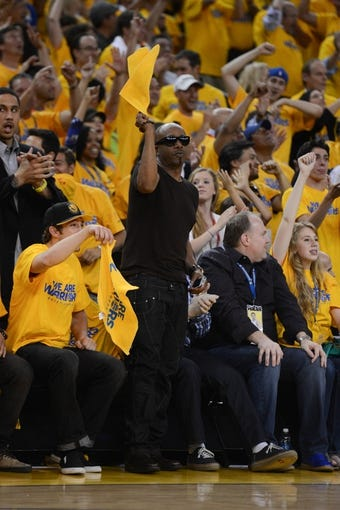 May 2, 2013; Oakland, CA, USA; Recording artist M.C. Hammer celebrates after a play during the fourth quarter of game six of the first round of the 2013 NBA Playoffs between the Golden State Warriors and the Denver Nuggets at Oracle Arena. The Warriors defeated the Nuggets 92-88. Mandatory Credit: Kyle Terada-USA TODAY Sports