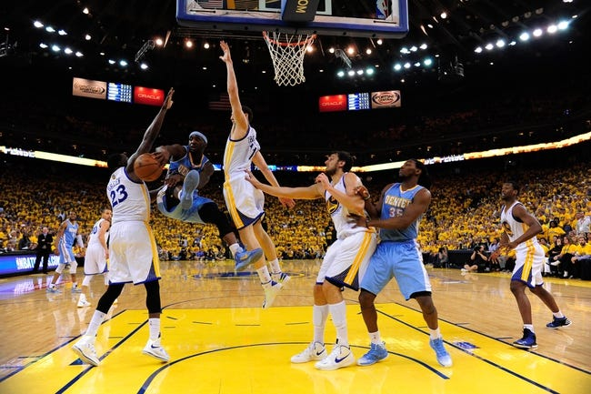 May 2, 2013; Oakland, CA, USA; Denver Nuggets point guard Ty Lawson (3, second from left) passes the ball defended by Golden State Warriors small forward Draymond Green (23) and shooting guard Klay Thompson (11) during the fourth quarter of game six of the first round of the 2013 NBA Playoffs at Oracle Arena. The Warriors defeated the Nuggets 92-88. Mandatory Credit: Kyle Terada-USA TODAY Sports