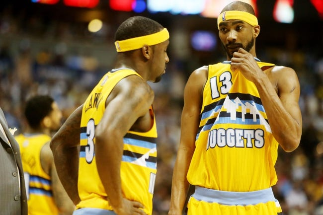 Apr 20, 2013; Denver, CO, USA; Denver Nuggets guard Ty Lawson (3) talks with forward Corey Brewer (13) during the second half of game one of the first round of the 2013 NBA Playoffs against the Golden State Warriors at the Pepsi Center. Mandatory Credit: Chris Humphreys-USA TODAY Sports