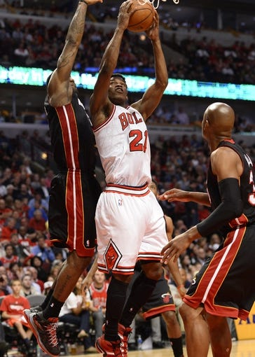 May 13, 2013; Chicago, IL, USA; Chicago Bulls small forward Jimmy Butler (21) shoots the ball against Miami Heat small forward LeBron James (6) during the second half at the United Center. Miami defeats Chicago 88-65. Mandatory Credit: Mike DiNovo-USA TODAY Sports