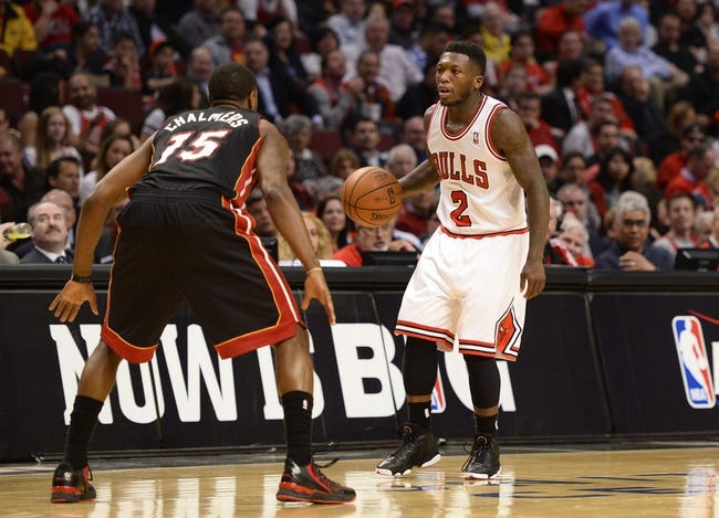 May 13, 2013; Chicago, IL, USA;  Chicago Bulls point guard Nate Robinson (2) dribbles the ball against Miami Heat point guard Mario Chalmers (15) during the second half at the United Center. Miami defeats Chicago 88-65. Mandatory Credit: Mike DiNovo-USA TODAY Sports