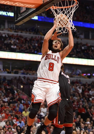 May 13, 2013; Chicago, IL, USA; Chicago Bulls shooting guard Marco Belinelli (8) shoots the ball against Miami Heat shooting guard Dwyane Wade (3) during the second half at the United Center. Miami defeats Chicago 88-65. Mandatory Credit: Mike DiNovo-USA TODAY Sports
