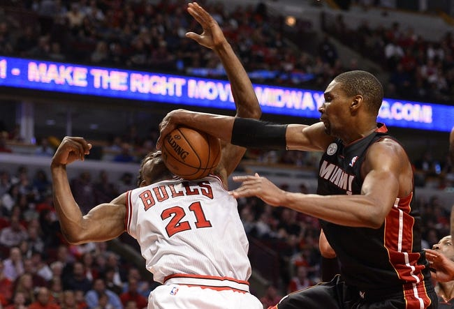 May 13, 2013; Chicago, IL, USA; Chicago Bulls small forward Jimmy Butler (21) attempts to shoot the ball against Miami Heat center Chris Bosh (1) during the second half at the United Center. Miami defeats Chicago 88-65. Mandatory Credit: Mike DiNovo-USA TODAY Sports