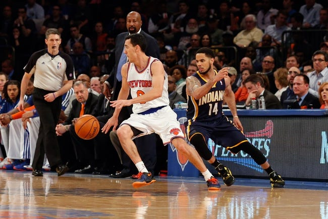 May 16, 2013; New York, NY, USA;  New York Knicks point guard Pablo Prigioni (9) strips the ball from Indiana Pacers point guard D.J. Augustin (14) during the third quarter of game five in the second round of the 2013 NBA Playoffs at Madison Square Garden. Knicks won 85-75.  Mandatory Credit: Anthony Gruppuso-USA TODAY Sports