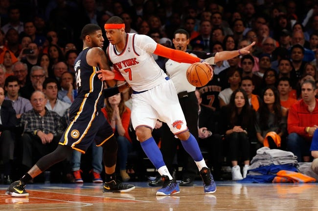 May 16, 2013; New York, NY, USA;  New York Knicks small forward Carmelo Anthony (7) drives past Indiana Pacers small forward Paul George (24) during the fourth quarter of game five in the second round of the 2013 NBA Playoffs at Madison Square Garden. Knicks won 85-75.  Mandatory Credit: Anthony Gruppuso-USA TODAY Sports