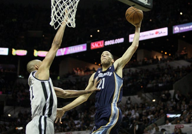 May 19, 2013; San Antonio, TX, USA; Memphis Grizzlies small forward Tayshaun Prince (21, right) attempts to dunk the ball as San Antonio Spurs power forward Tim Duncan (21, left) defends during the third quarter in game one of the Western Conference finals of the 2013 NBA Playoffs at AT&T Center. Mandatory Credit: Troy Taormina-USA TODAY Sports