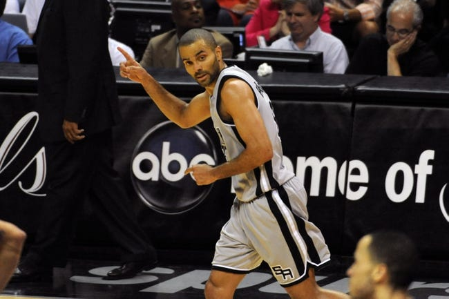 May 19, 2013; San Antonio, TX, USA; San Antonio Spurs guard Tony Parker (9) reacts against the Memphis Grizzlies in game one of the Western Conference finals of the 2013 NBA Playoffs at AT&T Center. San Antonio beat Memphis 105-83. Mandatory Credit: Brendan Maloney-USA TODAY Sports