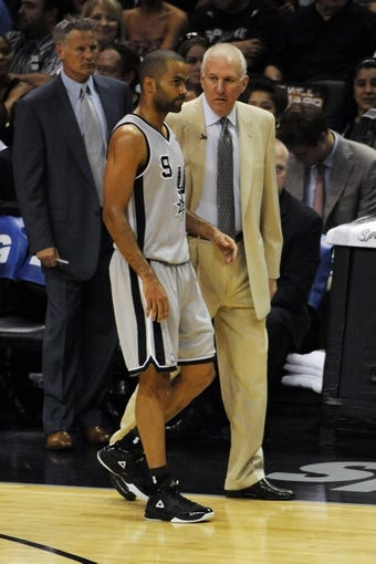 May 19, 2013; San Antonio, TX, USA; San Antonio Spurs guards Tony Parker (9) talks with head coach Gregg Popovich (right) against the Memphis Grizzlies in game one of the Western Conference finals of the 2013 NBA Playoffs at AT&T Center. San Antonio beat Memphis 105-83. Mandatory Credit: Brendan Maloney-USA TODAY Sports