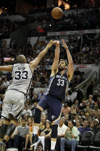 May 19, 2013; San Antonio, TX, USA; Memphis Grizzlies center Marc Gasol (33) shoots during the third quarter as San Antonio Spurs center Boris Diaw (33) defends in game one of the Western Conference finals of the 2013 NBA Playoffs at AT&T Center. Mandatory Credit: Troy Taormina-USA TODAY Sports