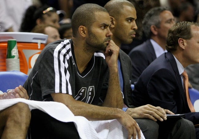May 19, 2013; San Antonio, TX, USA; San Antonio Spurs point guard Tony Parker (9) watches from the bench during the fourth quarter against the Memphis Grizzlies  in game one of the Western Conference finals of the 2013 NBA Playoffs at AT&T Center. Mandatory Credit: Troy Taormina-USA TODAY Sports