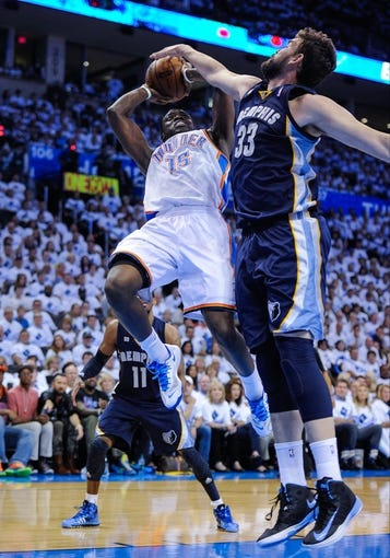 May 15, 2013; Oklahoma City, OK, USA; Memphis Grizzlies center Marc Gasol (33) blocks a shot by Oklahoma City Thunder point guard Reggie Jackson (15) during game five of the second round of the 2013 NBA Playoffs at Chesapeake Energy Arena. The Grizzlies defeated the Thunder 88-84. Mandatory Credit: Jerome Miron-USA TODAY Sports