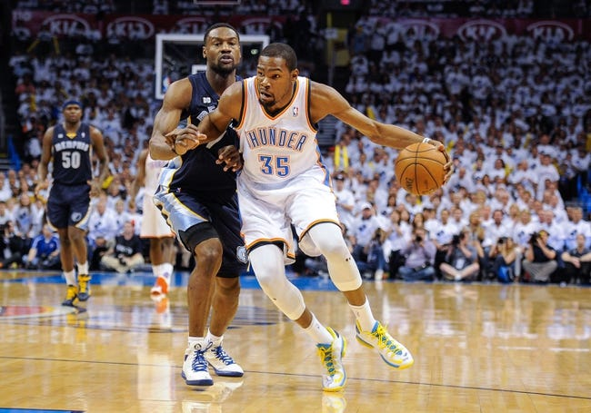 May 15, 2013; Oklahoma City, OK, USA; Oklahoma City Thunder small forward Kevin Durant (35) drives to the basket past Memphis Grizzlies shooting guard Tony Allen (9) during game five of the second round of the 2013 NBA Playoffs at Chesapeake Energy Arena. The Grizzlies defeated the Thunder 88-84. Mandatory Credit: Jerome Miron-USA TODAY Sports
