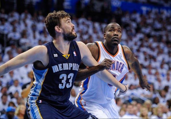May 15, 2013; Oklahoma City, OK, USA; Memphis Grizzlies center Marc Gasol (33) blocks out Oklahoma City Thunder center Kendrick Perkins (5) during game five of the second round of the 2013 NBA Playoffs at Chesapeake Energy Arena. The Grizzlies defeated the Thunder 88-84. Mandatory Credit: Jerome Miron-USA TODAY Sports