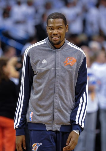 May 15, 2013; Oklahoma City, OK, USA; Oklahoma City Thunder small forward Kevin Durant (35) warms up before game five against the Memphis Grizzlies in the second round of the 2013 NBA Playoffs at Chesapeake Energy Arena. The Grizzlies defeated the Thunder 88-84. Mandatory Credit: Jerome Miron-USA TODAY Sports