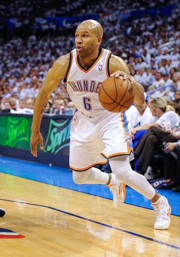 May 15, 2013; Oklahoma City, OK, USA; Oklahoma City Thunder point guard Derek Fisher (6) drives to the basket against the Memphis Grizzlies during game five of the second round of the 2013 NBA Playoffs at Chesapeake Energy Arena. The Grizzlies defeated the Thunder 88-84. Mandatory Credit: Jerome Miron-USA TODAY Sports