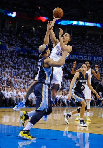 May 15, 2013; Oklahoma City, OK, USA; Oklahoma City Thunder shooting guard Kevin Martin (23) shoots over Memphis Grizzlies point guard Jerryd Bayless (7) during game five of the second round of the 2013 NBA Playoffs at Chesapeake Energy Arena. The Grizzlies defeated the Thunder 88-84. Mandatory Credit: Jerome Miron-USA TODAY Sports