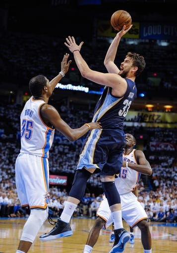 May 15, 2013; Oklahoma City, OK, USA; Memphis Grizzlies center Marc Gasol (33) shoots over Oklahoma City Thunder small forward Kevin Durant (35) during game five of the second round of the 2013 NBA Playoffs at Chesapeake Energy Arena. The Grizzlies defeated the Thunder 88-84. Mandatory Credit: Jerome Miron-USA TODAY Sports
