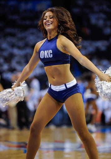 May 15, 2013; Oklahoma City, OK, USA; A Oklahoma City Thunder dancer performs during a timeout in game five between the Thunder and the Memphis Grizzlies in the second round of the 2013 NBA Playoffs at Chesapeake Energy Arena. The Grizzlies defeated the Thunder 88-84. Mandatory Credit: Jerome Miron-USA TODAY Sports