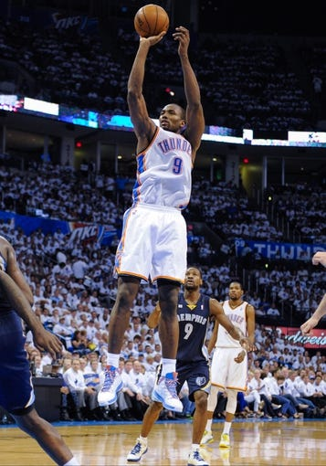 May 15, 2013; Oklahoma City, OK, USA; Oklahoma City Thunder power forward Serge Ibaka (9) makes a jump shot during game five against the Memphis Grizzlies in the second round of the 2013 NBA Playoffs at Chesapeake Energy Arena. The Grizzlies defeated the Thunder 88-84. Mandatory Credit: Jerome Miron-USA TODAY Sports