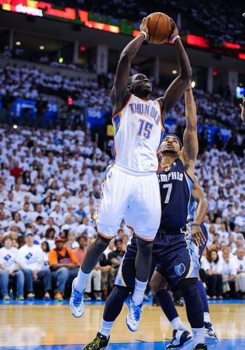 May 15, 2013; Oklahoma City, OK, USA; Oklahoma City Thunder point guard Reggie Jackson (15) shoots over Memphis Grizzlies point guard Jerryd Bayless (7) during game five of the second round of the 2013 NBA Playoffs at Chesapeake Energy Arena. The Grizzlies defeated the Thunder 88-84. Mandatory Credit: Jerome Miron-USA TODAY Sports