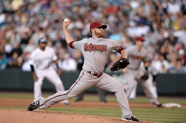 May 21, 2013; Denver, CO, USA; Arizona Diamondbacks starting pitcher Ian Kennedy (31) delivers a pitch against the Colorado Rockies in the second inning at Coors Field. Mandatory Credit: Ron Chenoy-USA TODAY Sports