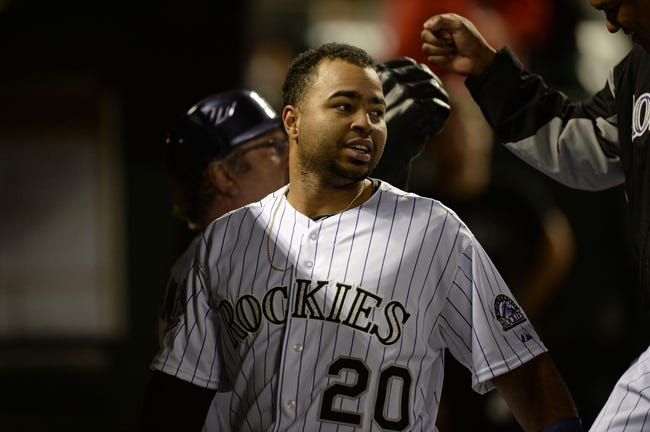 May 21, 2013; Denver, CO, USA; Colorado Rockies catcher Wilin Rosario (20) reacts to game winning single base hit in the tenth inning against the Arizona Diamondbacks at Coors Field. The Rockies defeated the Diamondbacks 5-4 in ten innings. Mandatory Credit: Ron Chenoy-USA TODAY Sports