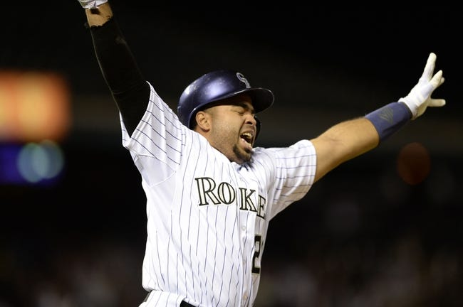 May 21, 2013; Denver, CO, USA; Colorado Rockies catcher Wilin Rosario (20) reacts to game winning single base hit in the tenth inning against the Arizona Diamondbacks at Coors Field. The Rockies defeated the Diamondbacks 5-4 in tenth innings. Mandatory Credit: Ron Chenoy-USA TODAY Sports