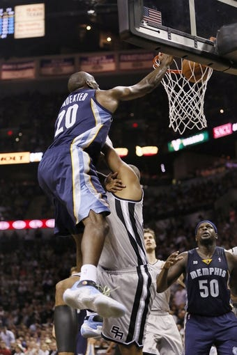 May 21, 2013; San Antonio, TX, USA; Memphis Grizzlies forward Quincy Pondexter (20) dunks over San Antonio Spurs forward Boris Diaw (bottom) in game two of the Western Conference finals of the 2013 NBA Playoffs at AT&T Center. Mandatory Credit: Soobum Im-USA TODAY Sports