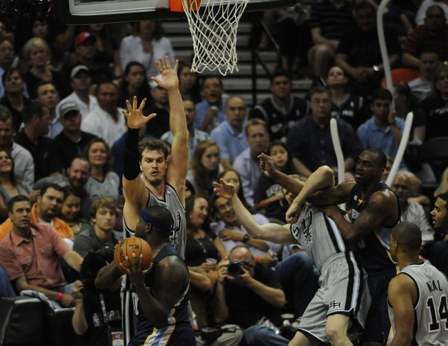 May 21, 2013; San Antonio, TX, USA; San Antonio Spurs forward Tiago Splitter (22) defends against Memphis Grizzlies forward Zach Randolph (50) in game two of the Western Conference finals of the 2013 NBA Playoffs at AT&T Center. San Antonio beat Memphis 93-89. Mandatory Credit: Brendan Maloney-USA TODAY Sports
