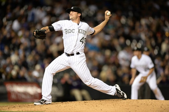 May 21, 2013; Denver, CO, USA; Colorado Rockies relief pitcher Rex Brothers (49) delivers a pitch against the Arizona Diamondbacks at Coors Field. The Rockies defeated the Diamondback 5-4 in ten innings. Mandatory Credit: Ron Chenoy-USA TODAY Sports