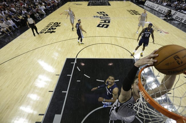 May 21, 2013; San Antonio, TX, USA; San Antonio Spurs forward Tiago Splitter (22) dunks in game two of the Western Conference finals of the 2013 NBA Playoffs against the Memphis Grizzlies at AT&T Center. Mandatory Credit: Ronald Martinez/Getty Images-Pool Photo via USA TODAY Sports