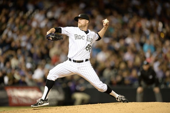 May 21, 2013; Denver, CO, USA; Colorado Rockies relief pitcher Josh Outman (88) delivers a pitch against the Arizona Diamondbacks at Coors Field. The Rockies defeated the Diamondback 5-4 in ten innings. Mandatory Credit: Ron Chenoy-USA TODAY Sports