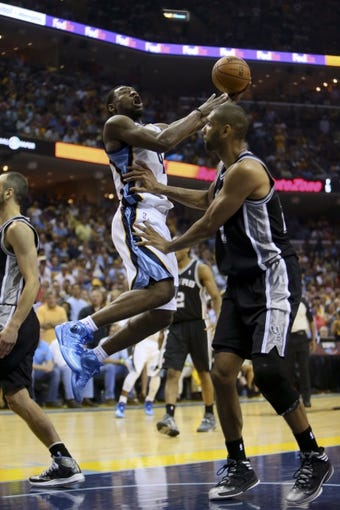 May 25, 2013; Memphis, TN, USA; Memphis Grizzlies shooting guard Tony Allen (9) shoots the ball over San Antonio Spurs power forward Tim Duncan (21) in game three of the Western Conference finals of the 2013 NBA Playoffs at FedEx Forum. San Antonio Spurs defeat the Memphis Grizzlies 104-93, and lead the series 3-0.  Mandatory Credit: Spruce Derden-USA TODAY Sports