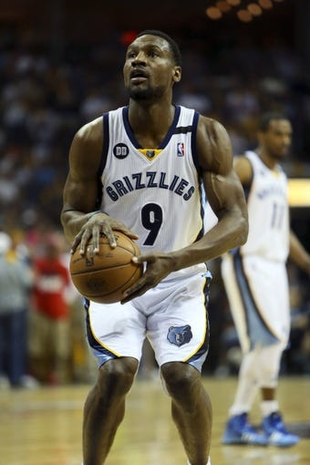 May 25, 2013; Memphis, TN, USA; Memphis Grizzlies shooting guard Tony Allen (9) shoots a free throw in game three of the Western Conference finals of the 2013 NBA Playoffs against the San Antonio Spurs at FedEx Forum. San Antonio Spurs defeat the Memphis Grizzlies 104-93, and lead the series 3-0.  Mandatory Credit: Spruce Derden-USA TODAY Sports