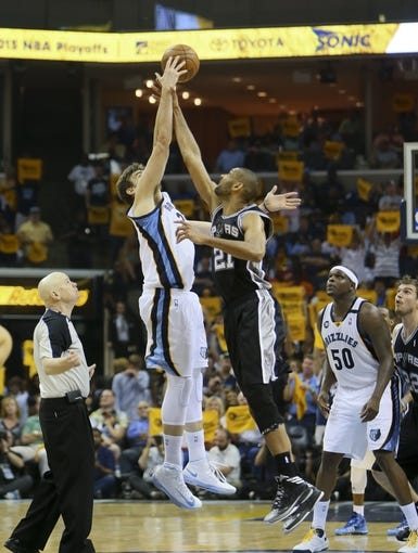 May 25, 2013; Memphis, TN, USA; Memphis Grizzlies center Marc Gasol (33) and San Antonio Spurs power forward Tim Duncan (21) go up for the overtime tip off in game three of the Western Conference finals of the 2013 NBA Playoffs at FedEx Forum. San Antonio Spurs defeat the Memphis Grizzlies 104-93, and lead the series 3-0.  Mandatory Credit: Spruce Derden-USA TODAY Sports