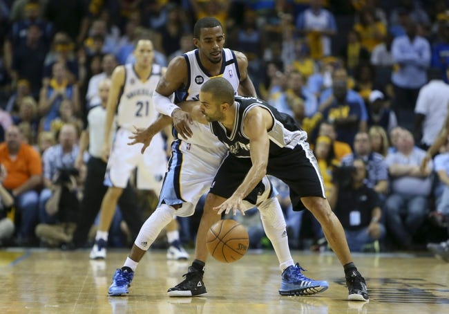 May 25, 2013; Memphis, TN, USA; San Antonio Spurs point guard Tony Parker (9) sets the play while guarded by Memphis Grizzlies point guard Mike Conley (11) in game three of the Western Conference finals of the 2013 NBA Playoffs at FedEx Forum. San Antonio Spurs defeat the Memphis Grizzlies 104-93, and lead the series 3-0.  Mandatory Credit: Spruce Derden-USA TODAY Sports