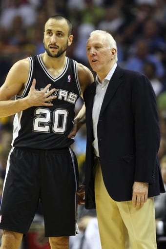 May 25, 2013; Memphis, TN, USA; San Antonio Spurs head coach Gregg Popovich and San Antonio Spurs shooting guard Manu Ginobili (20) have a discussion in game three of the Western Conference finals of the 2013 NBA Playoffs against the Memphis Grizzlies at FedEx Forum. San Antonio Spurs defeat the Memphis Grizzlies 104-93, and lead the series 3-0.  Mandatory Credit: Spruce Derden-USA TODAY Sports