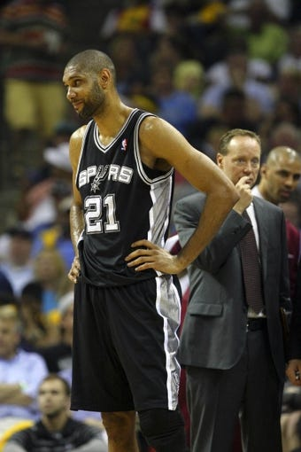 May 25, 2013; Memphis, TN, USA; San Antonio Spurs power forward Tim Duncan (21) in game three of the Western Conference finals of the 2013 NBA Playoffs against the Memphis Grizzlies at FedEx Forum. San Antonio Spurs defeat the Memphis Grizzlies 104-93, and lead the series 3-0.  Mandatory Credit: Spruce Derden-USA TODAY Sports