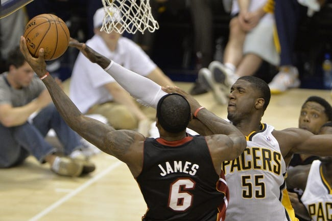 May 26, 2013; Indianapolis, IN, USA; Indiana Pacers center Roy Hibbert (55) tries to block a shoot by Miami Heat small forward LeBron James (6) during the third quarter in game three of the Eastern Conference finals of the 2013 NBA Playoffs at Bankers Life Fieldhouse. Miami defeated Indiana 114-96.  Mandatory Credit: Jamie Rhodes-USA TODAY Sports