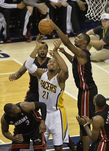 May 26, 2013; Indianapolis, IN, USA; Miami Heat center Chris Bosh (1) knocks a rebound away from Indiana Pacers power forward David West (21) during the third quarter in game three of the Eastern Conference finals of the 2013 NBA Playoffs at Bankers Life Fieldhouse. Miami defeated Indiana 114-96.  Mandatory Credit: Jamie Rhodes-USA TODAY Sports