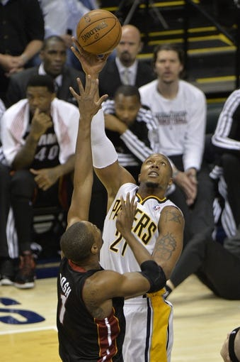 May 26, 2013; Indianapolis, IN, USA; Indiana Pacers power forward David West (21) shoots over Miami Heat center Chris Bosh (1) during the fourth quarter in game three of the Eastern Conference finals of the 2013 NBA Playoffs at Bankers Life Fieldhouse. Miami defeated Indiana 114-96.  Mandatory Credit: Jamie Rhodes-USA TODAY Sports